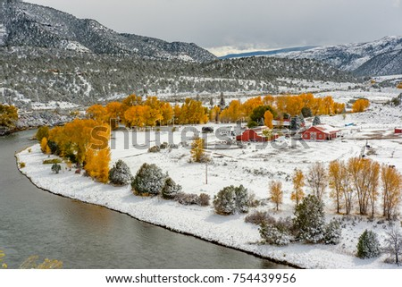 Season changing, first snow and autumn trees. Rocky Mountains, Colorado, USA.