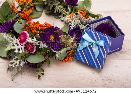 Seasonal autumn wreath with flowers and berries