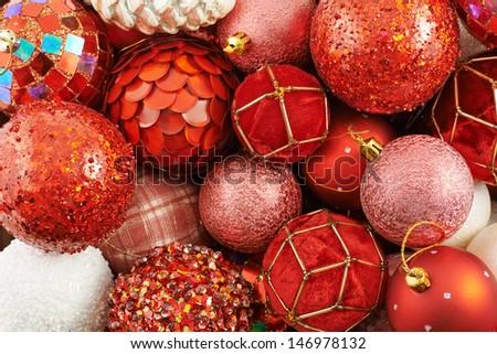 Seasonal Christmas decoration background as a pile of xmas tree decorations - stock photo
