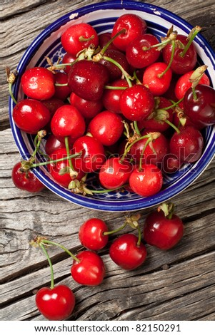 seasonal fresh cherry fruit on basket - stock photo