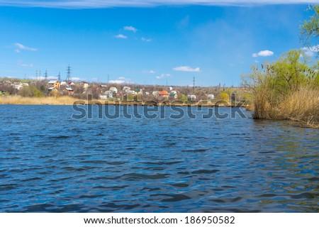 Seasonal landscape with small Ukrainian river Sura - stock photo