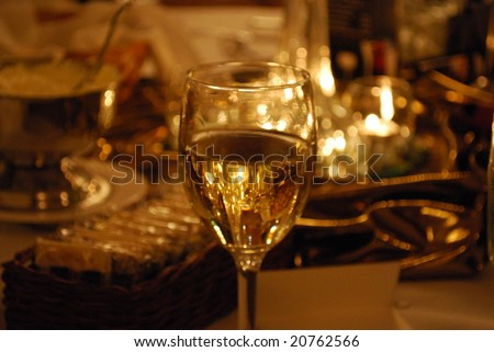 Seasonal/Romantic Candle Table Centerpiece, Focused Through a Glass of Wine - stock photo