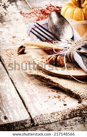 Seasonal table setting with decorative pumpkin  - stock photo