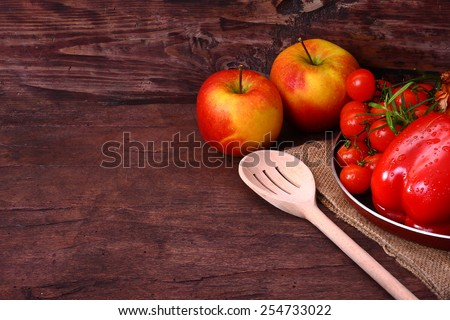 Seasonal table with fresh vegetables and fruit - stock photo