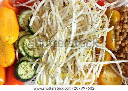 Seasoned vegetables ready to cook: bean sprouts, mini peppers, yellow tomatoes, zuchinni and lentils. - stock photo