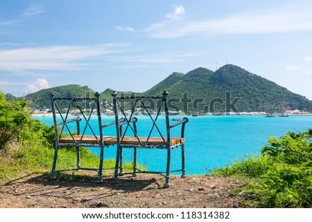 Seat at overlook viewpoint over Philipsburg in Sint Maarten St Martin Caribbean - stock photo