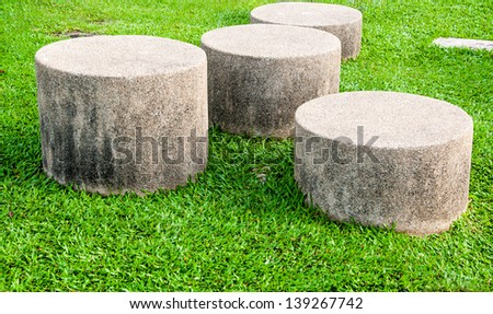 seat made of Stones on the Lawn - stock photo
