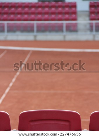 Seat on a clay tennis court without any people - stock photo