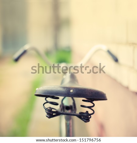 seat with shock absorbers old bicycle - stock photo
