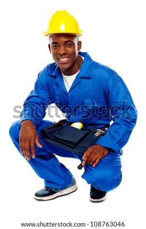 Seated african worker posing with a smile isolated over white background - stock photo