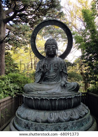 Seated Buddha Statue in the Japanese Gardens in San Francisco Golden Gate Park - stock photo