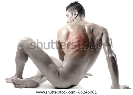 Seated man with backache - stock photo