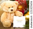 Seated teddy bear with gift - stock photo
