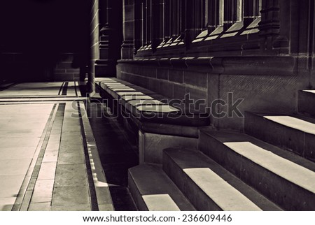 Seating area in old sandstone cathedral - stock photo