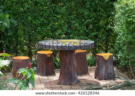 seating bench made from concrete with paint color at Beautiful garden - stock photo