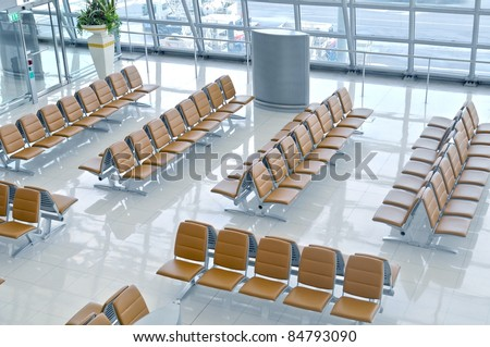 Seats in a departure gate of Bangkok Airport in Thailand - stock photo