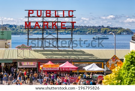 SEATTLE-APR 12, 2014: Historic Pike Place Public Market is one of the top attractions in Seattle, where locals and tourists shop for locally sourced, artisanal and specialty foods, flowers and crafts. - stock photo
