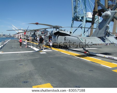 SEATTLE - AUG 4 : Civilians inspect an SH-60 Seahawk [variation  army's UH-60 Blackhawk helicopter]during a tour of the Amphibious Assault Ship Bonhomme Richard, LDH-6,  on Aug 4, 2011, in Seattle.