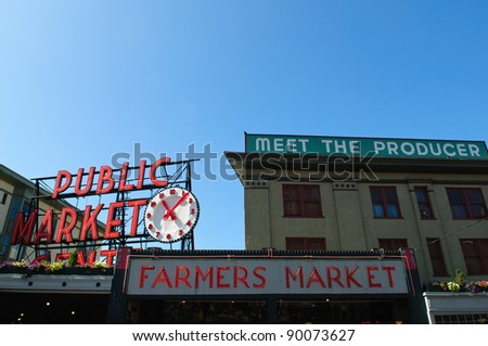 SEATTLE - AUGUST 19: The Pike Place Public Market Historic District on August 19, 2011 in Seattle, USA. Pike Place Market is a market in the United States serving 10 million people annually. - stock photo