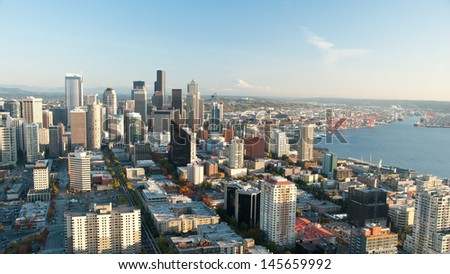 Seattle downtown skyline with view of Mt.Rainier in distance panorama - stock photo