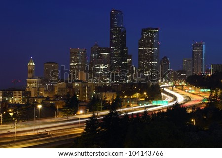 Seattle Downtown Twilight. Seattle skyline at twilight and Interstate 5 passing through the city. Washington State, USA.