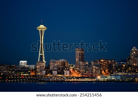 Seattle downtown with Space Needle iconic night view from Alki Beach Part - stock photo