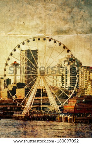 Seattle ferris wheel, space needle, waterfront and skyline toned with vintage color,textures and folded paper creases. Copy space. - stock photo
