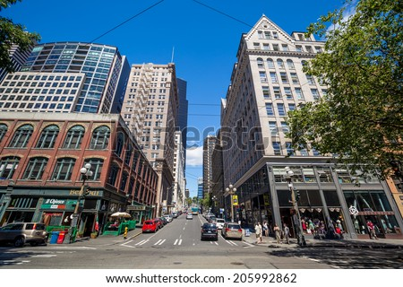SEATTLE - JULY 5: Downtown Seattle on July 5, 2014. In 1989, building heights in Downtown and adjoining Seattle suburbs were tightly restricted following a voter initiative.