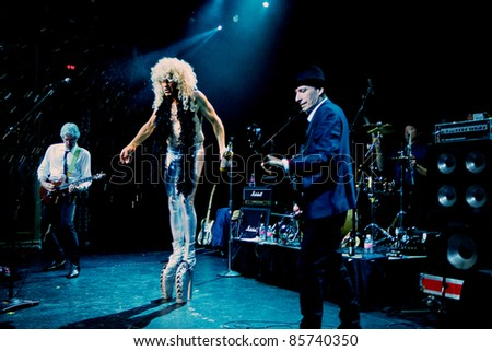 SEATTLE - JULY 1:  Singer Fee Waybill dressed in drag as his infamous character Quay Lewd of the rock band the Tubes performs on stage at the Triple Door Theater in Seattle, WA on July 1, 2011.