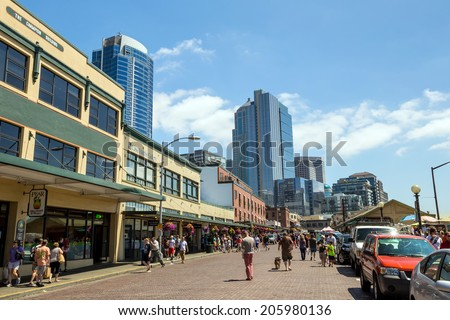SEATTLE - JULY 5: The Public Market Center also known worldwide as Pike Place Market in Seattle, Washington on July 5, 2014. - stock photo