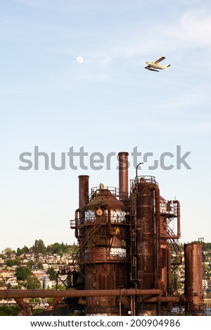 SEATTLE - MAY 11: A seaplane flies above Gas Works Park in Seattle, Washington on May 11, 2014. - stock photo