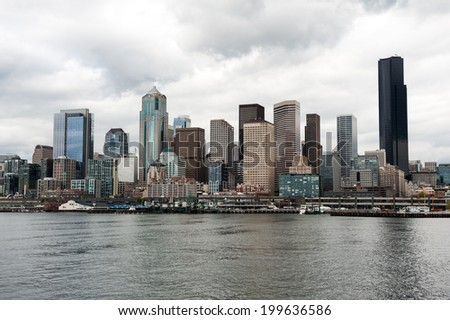 SEATTLE - MAY 10: An overcast view of the Seattle skyline seen from Elliott Bay on May 10, 2014. - stock photo