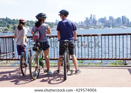 SEATTLE - MAY 30, 2016 - Bicyclists take a rest stop on Memorial Day in Gas Works Park - stock photo