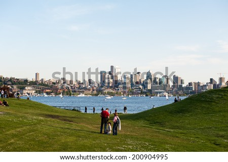 SEATTLE - MAY 11: Families and friends gather at Gas Works Park in Seattle which overlooks Lake Union and the Seattle Skyline on May 11, 2014.