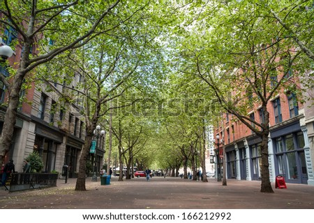 SEATTLE - MAY 19: Occidental Avenue on May 19 in Seattle. Occidental Park is in the heart of the historic Pioneer Square district, built in 1971, during the general renovation of the area. - stock photo