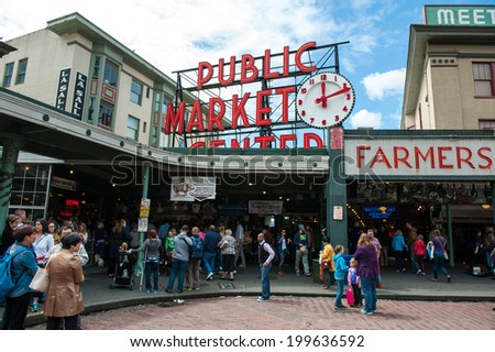 SEATTLE - MAY 10: Pike Pace Market is a historic, multi-level public market in Seattle home to over 200 independent businesses as seen on May 10, 2014. - stock photo