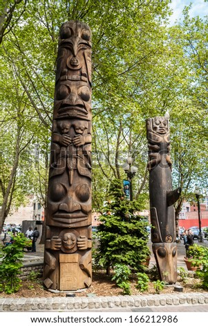 SEATTLE - MAY 19: Totem poles on Pioneer Square on May 19, 2007 in Seattle. Pioneer Square was city center where founders settled in 1852; most of buildings on it burnt in 1889 great fire.