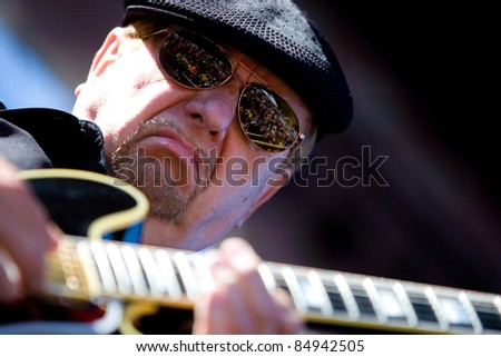 SEATTLE - SEPT 5:  American Guitarist Dennis Coffey plays his guitar on stage during the Bumbershoot music festival in Seattle on September 5, 2011.
