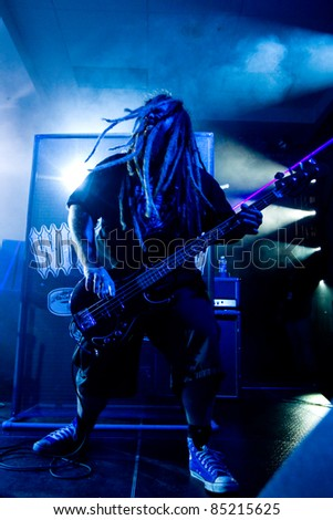 SEATTLE - SEPT. 3:  Jacy Peckham of Heavy Metal rock band playing bass and shaking his long dreadlocks during the Bumbershoot music festival in Seattle on September 3, 2011.