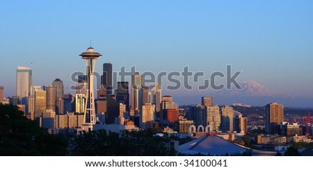 Seattle Skyline and Mount Rainier at Sunset from Kerry Park - stock photo
