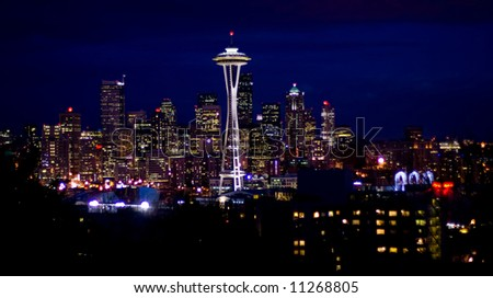 Seattle skyline at night viewed from the highland street on Quenn Anne hill - stock photo