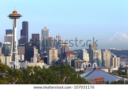 Seattle skyline at sunset and Mt.Rainier.
