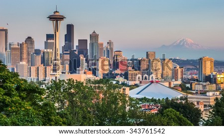 Seattle skyline panorama seen from Kerry Park at sunset in golden evening light with Mount Rainier in the background, Washington State, United States of America - stock photo