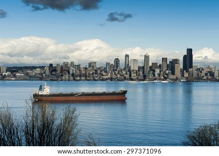 Seattle Skyline. The beautiful Seattle skyline with a ship in Elliott Bay in the foreground.