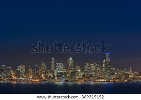 Seattle Skyline. The view across Elliott Bay of the Seattle skyline during a glorious sunset with modern office buildings, ferry terminal, and the Alaska Way viaduct. - stock photo