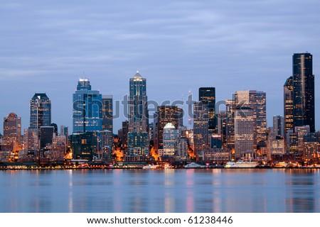 Seattle skyline- Washington USA. Buildings along waterfront at twilight. - stock photo