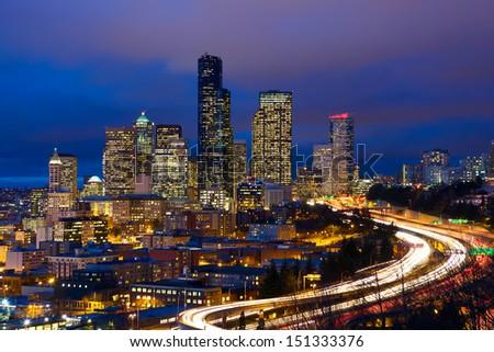 Seattle skyline with traffic at dusk, WA, USA - stock photo