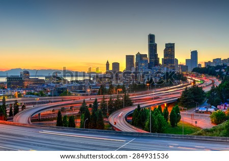Seattle skylines and highway traffic in the sunset. The view from Rizal Park in Seattle, Washington, US - stock photo