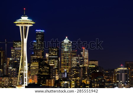 Seattle skylines in blue hour, the view from Kerry Park in Queen Anne Hill, Seattle, Washington State, USA. Mount Rainer can be seen from background. - stock photo