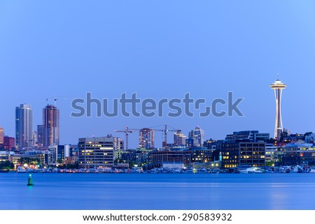 Seattle Skylines with light reflection on Lake Union in blue hour. The view from Gas Works Park � a tourists attraction and popular local place. - stock photo